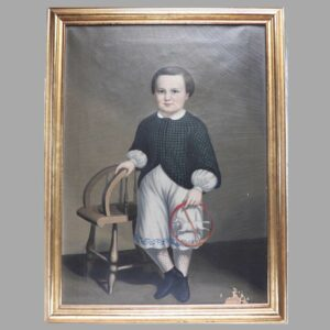 12-21518 Full length portrait of a boy holding a horse toy Image