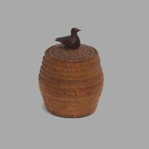 31-22288x, Birch chip carved lidded jar, cover saffron, folky bird finial, 19th century. $1,295