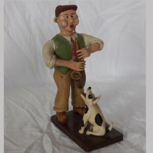 14-23785, Carved wood figure of a man playing the saxophone and dog, Berks/Lancaster co PA, 20th century. $1,295