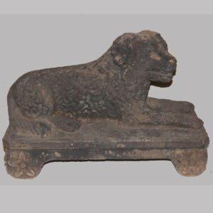 26-13904x, Reclining dog on plinth, black sandstone garden figure, probably English, early 19th century. $22,500