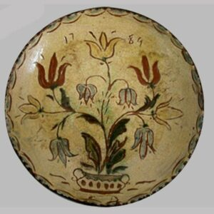Redware plate sgraffito decorated, pot of flowers.  Rare blue slip.