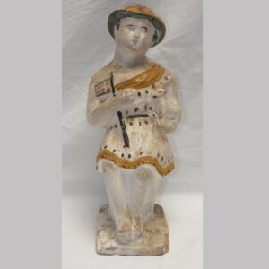 22-5689, Chalk figure of a woman holding a lamb and flag. $975