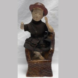 31-22653, Chalk figure of a seated boy in fabric dress, some loss. $750