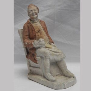 2-14408, Chalk figure of a seated gent holding ale mug. $595