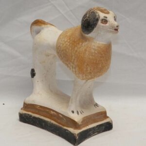 28-18981, Chalk standing poodle on base yellow and browns, black trim. $695