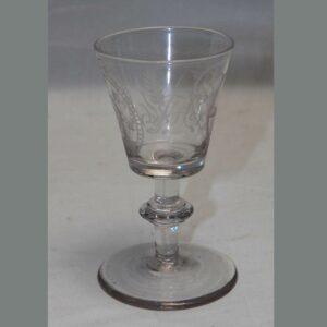 15-25652, Blown flint glass stemmed wine, masonic symbols, wheel engraved, early 19th century. $395
