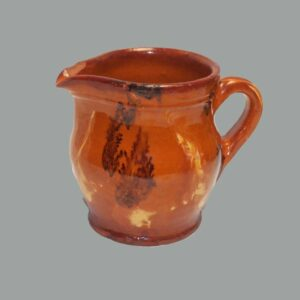 31-20555, PA redware handled pitcher orange glaze yellow slip and black seaweed. $1,200