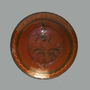 "15-26081, 11 1/2"" PA redware charger, green and yellow slip decoration, late 18th early 19th century. $5,250"