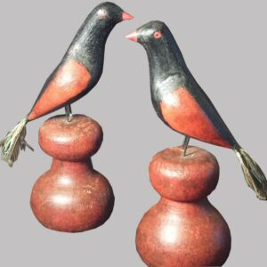 31-22529, Pair of folk art carved wood birds on later plinths, polychrome paint, real tail feathers, PA late 19th century. $2,250