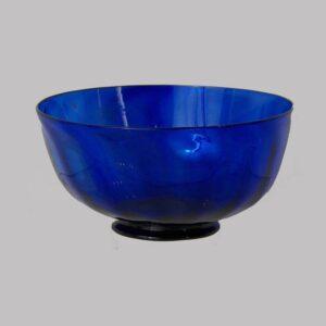 23-10547, Stiegel type blown flint glass cobalt blue footed bowl, vertical swirl panels. $695