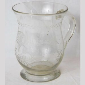 25-12811, Rare form mug blown glass, applied handle, wheel engraved tulip design. $495