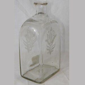 16-26801, Stiegel type blown flint glass bottle, wheel engraved tulip pattern. $175