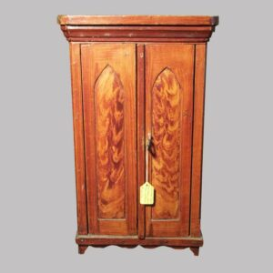 23-9122, Miniature paint decorated 2 door cupboard, cathedral panel doors, red flame and grain paint, with blue interior. $2,250