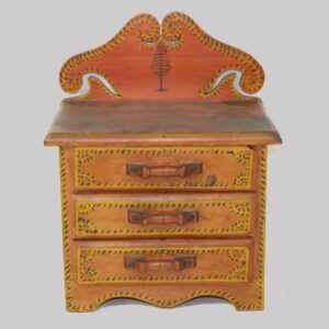 29-19163, Miniature paint decorated three drawer chest, initialed EMB, salmon and yellow. $3,850