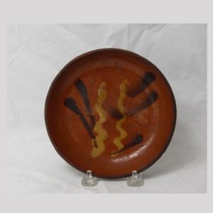 "21-8511x, 6 1/2"" redware plate 2 color slip decoration, Berks Co., PA. $1,950"