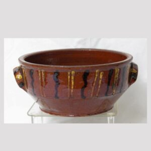 25-18320, PA redware pottery bowl yellow and black slip decoration, early 19th century. $3,450
