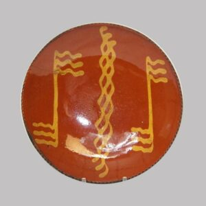 "12-21861, 9"" PA Redware pottery plate, yellow slip decoration. $595"