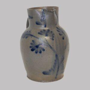 28-18441, Stoneware pitcher, unusual cobalt blue vine and floral decoration. $1,600