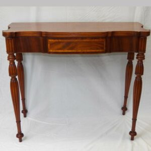 14-23773, New England birch and mahogany fold top card table, shaped top, turned legs. $4,500