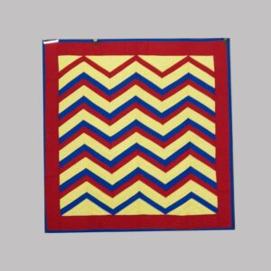 23-7204, Early 20th century crib quilt red blue and yellow zig zag design, Lancaster Co., PA. $1,695