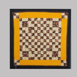 31-22472, Graphic crib quilt, early printed fabric on orange background, Lancaster/Lebanon Co., PA. $695