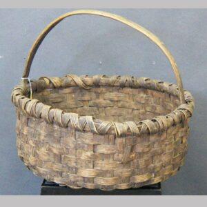 """2-7079, Low form handled oak splint basket, PA, 16"""" wide. $275"""