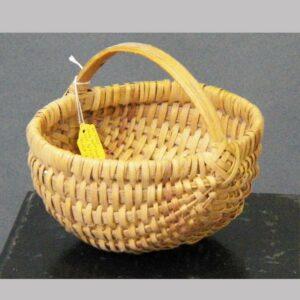 """23-9761, 20th century oak splint basket handled, Berks Co., PA, light red trim, 7 1/2"""" wide. $175"""