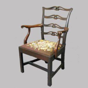 15-25763, Philadelphia mahogany ribbon back arm chair, shaped scrolled arm, 1790-1810. $2,950