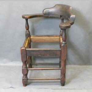 15-24760, Queen Ann corner chair, shaped crest, block and turned post legs, New England, later 18th century. $1,250