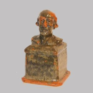 15-25009, PA Redware penny bank, profile of George Washington, 2 tone glaze. $8,500