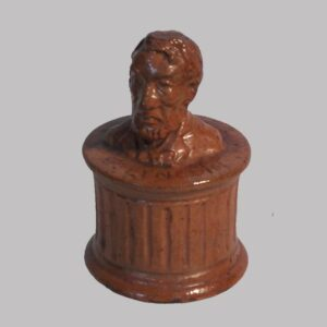 15-25010, PA Redware pottery penny bank profile of Abe Lincoln, inscribed. $8,500