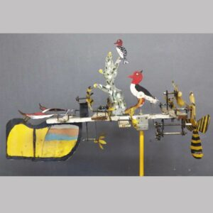 Metal whirligig, wood pecker pecking tree, neat paint. $