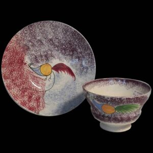16-27697 Red, Blue, and Purple Spatter Cup and Saucer Image
