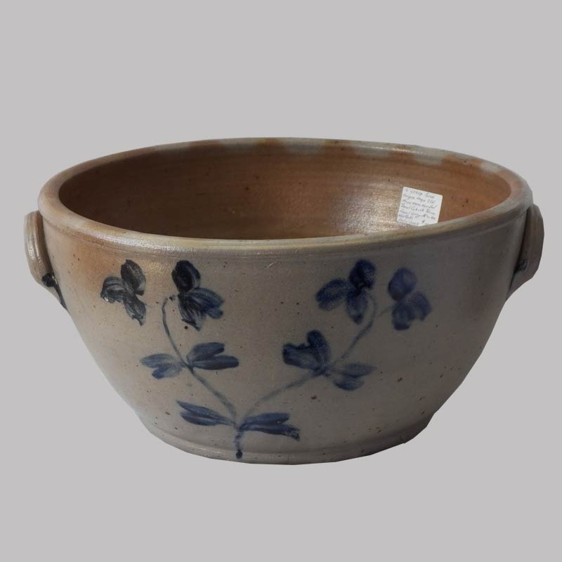 16-27924, Large  size 3 gallon stoneware handled bowl, blue floral decoration, Attr. to Herman Balt., sealed crack in bottom. $3,850