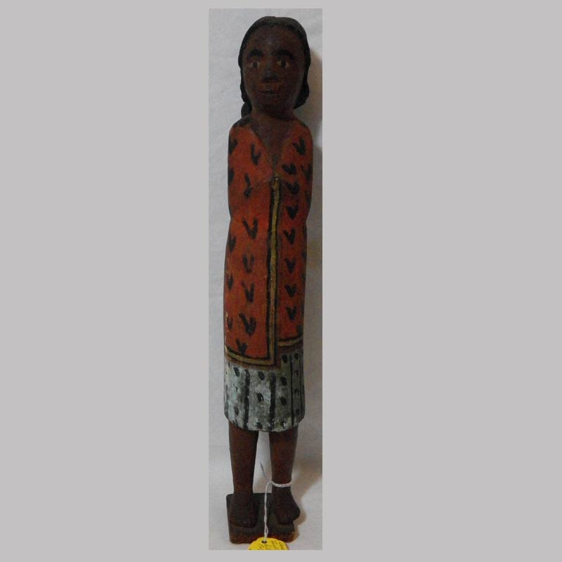 """26-14842X, Folk art carved wood figure of a native American woman, polychrome paint, late 18thc, 15"""" H. $775"""
