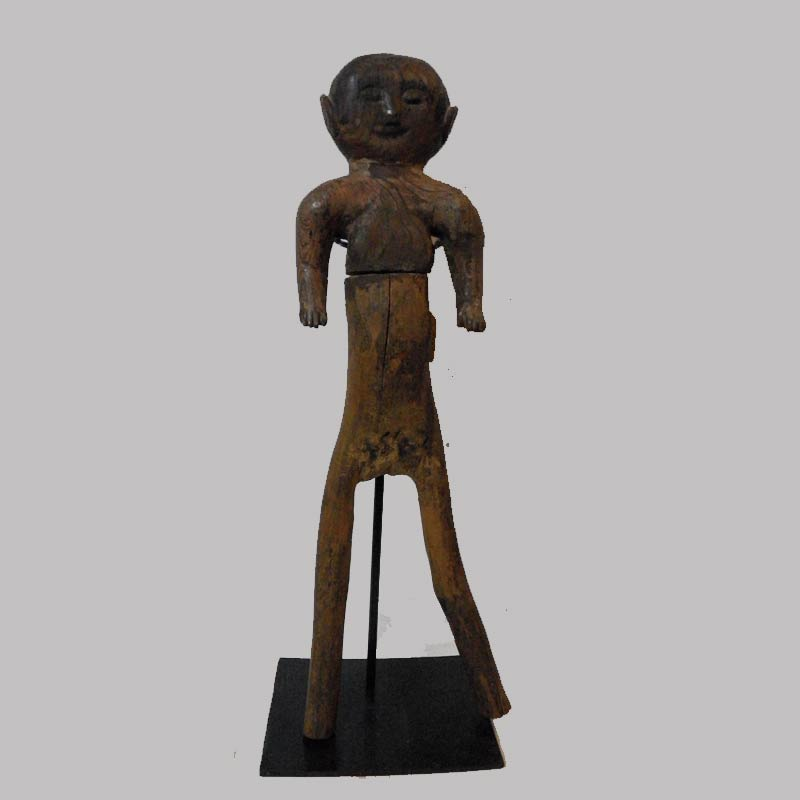 """26-14852, Primitive wood figure of a man, probably a doll toy, later 19th early 20th c, 20"""" H. $2,750"""
