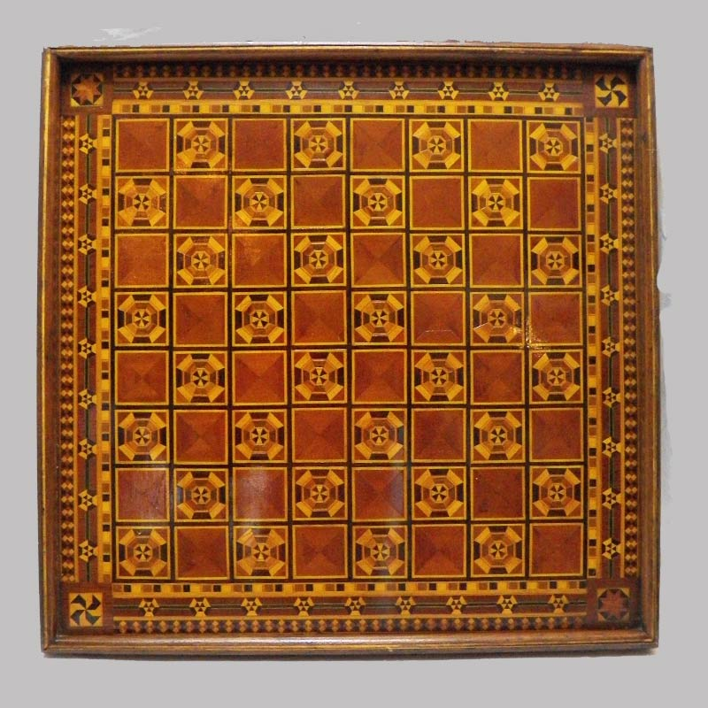 """29-19887, Exceptional, graphic inlayed game board various mixed woods dovetailed case PA, 1880-90's, 18"""" sq. $1,595"""