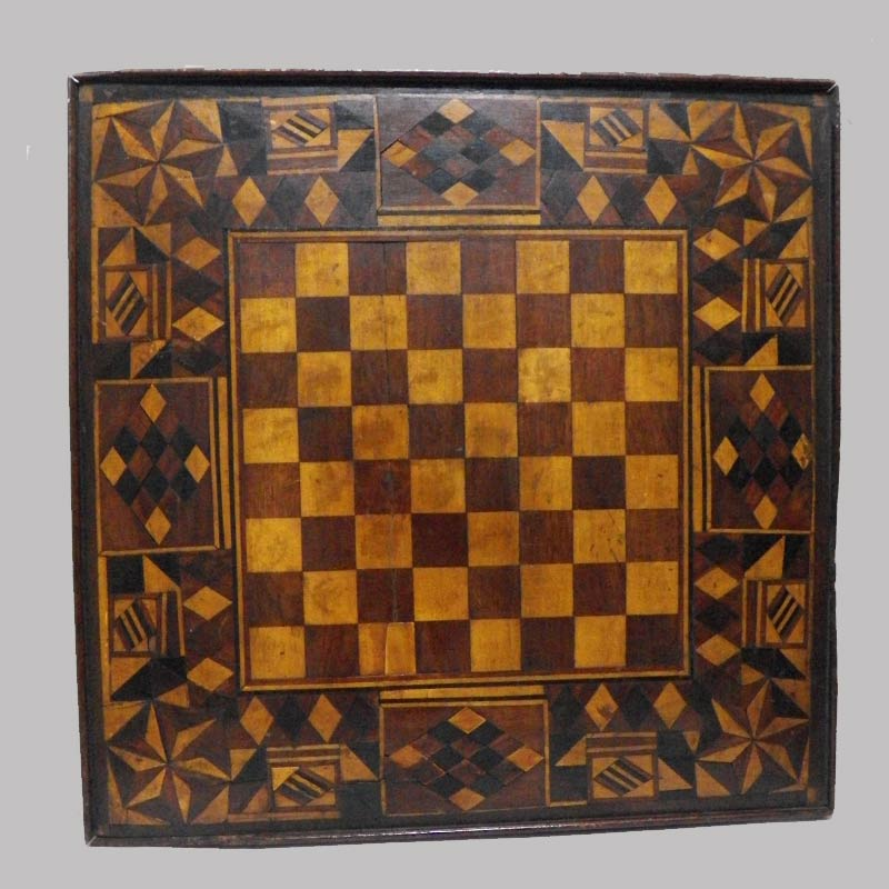 """15-25794, Inlayed game board various woods in folky geometric designs, probably PA, 19th century, 21"""" sq. $1,250"""