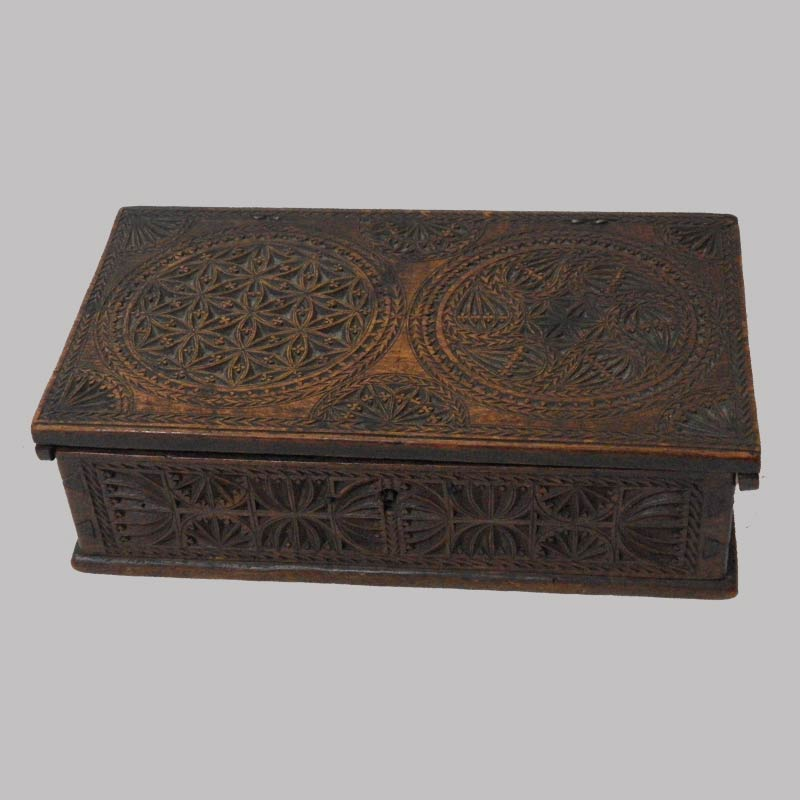 """13-22230, Dovetailed chip carved box, fine detail with various designs late 18th century, probably American. 8"""" L by 2"""" H. $3,950"""