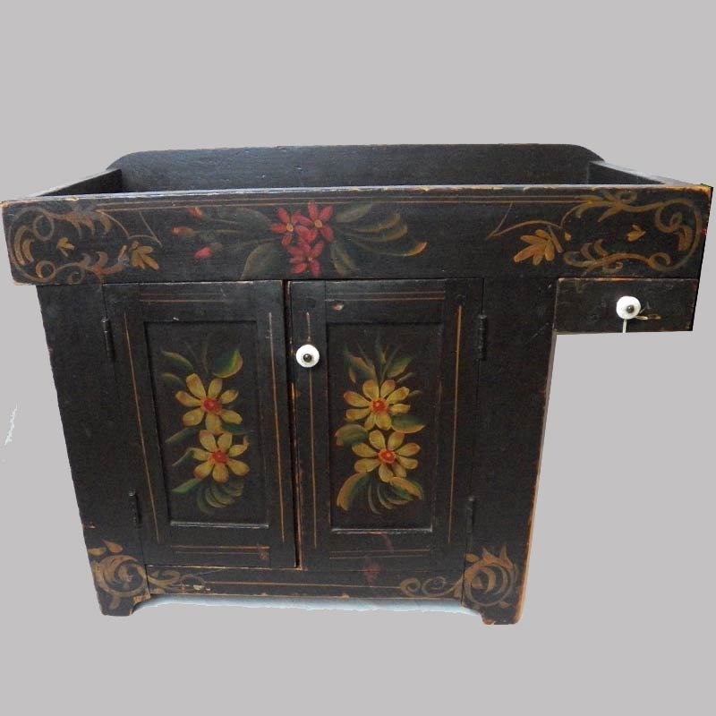 """17-28696, PA paint decorated childs size dry sink, original polychrome paint, floral on brown, 19th century. 24"""" L by 19"""" H. $2,250"""
