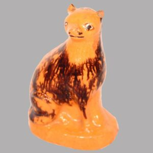 """15-25340, PA Redware pottery figural of a seated cat manganese splash and yellow slip eyes, rare form, ear wear, 4""""H. Image"""
