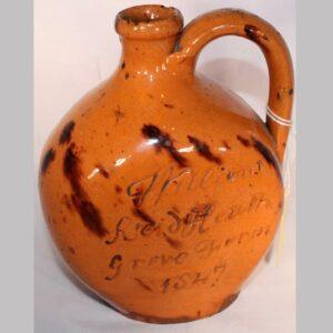 30-20290, Redware handled presentation jug incised William Reid Heath Grove Farm 1847. 6 1/2