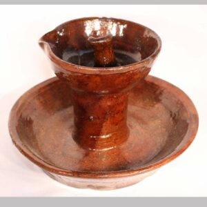 """14-23966, PA Redware saucer base fat lamp, rim nick. 4 1/2"""" high by 6"""" wide. Image"""