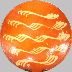 """18-32184, 12"""" PA Redware plate with yellow slip decoration, good color and condition. Image"""