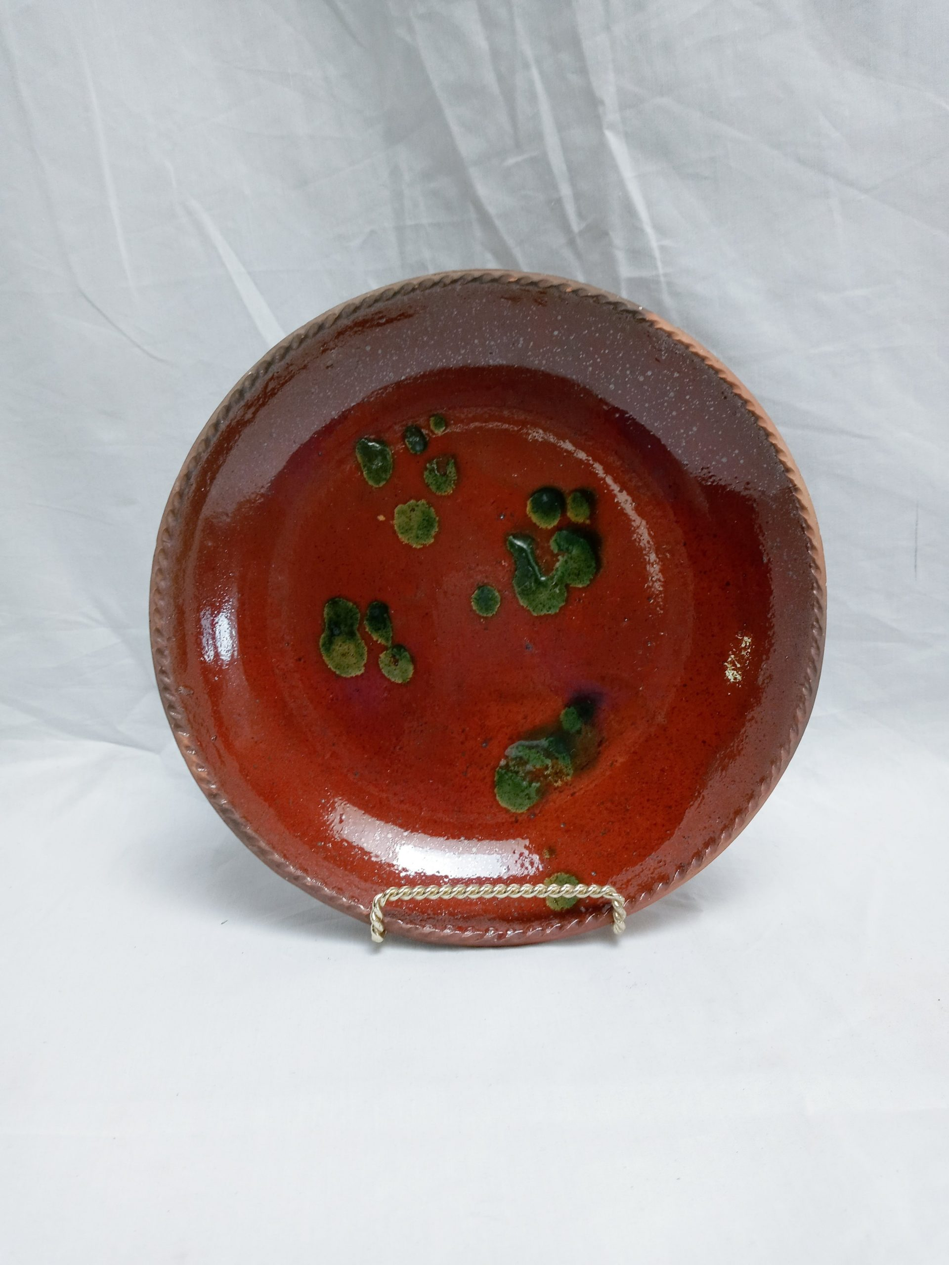 18-31463 Redware Pottery Plate, Singer Pottery family, green and yellow slip decoration, unused condition. Image