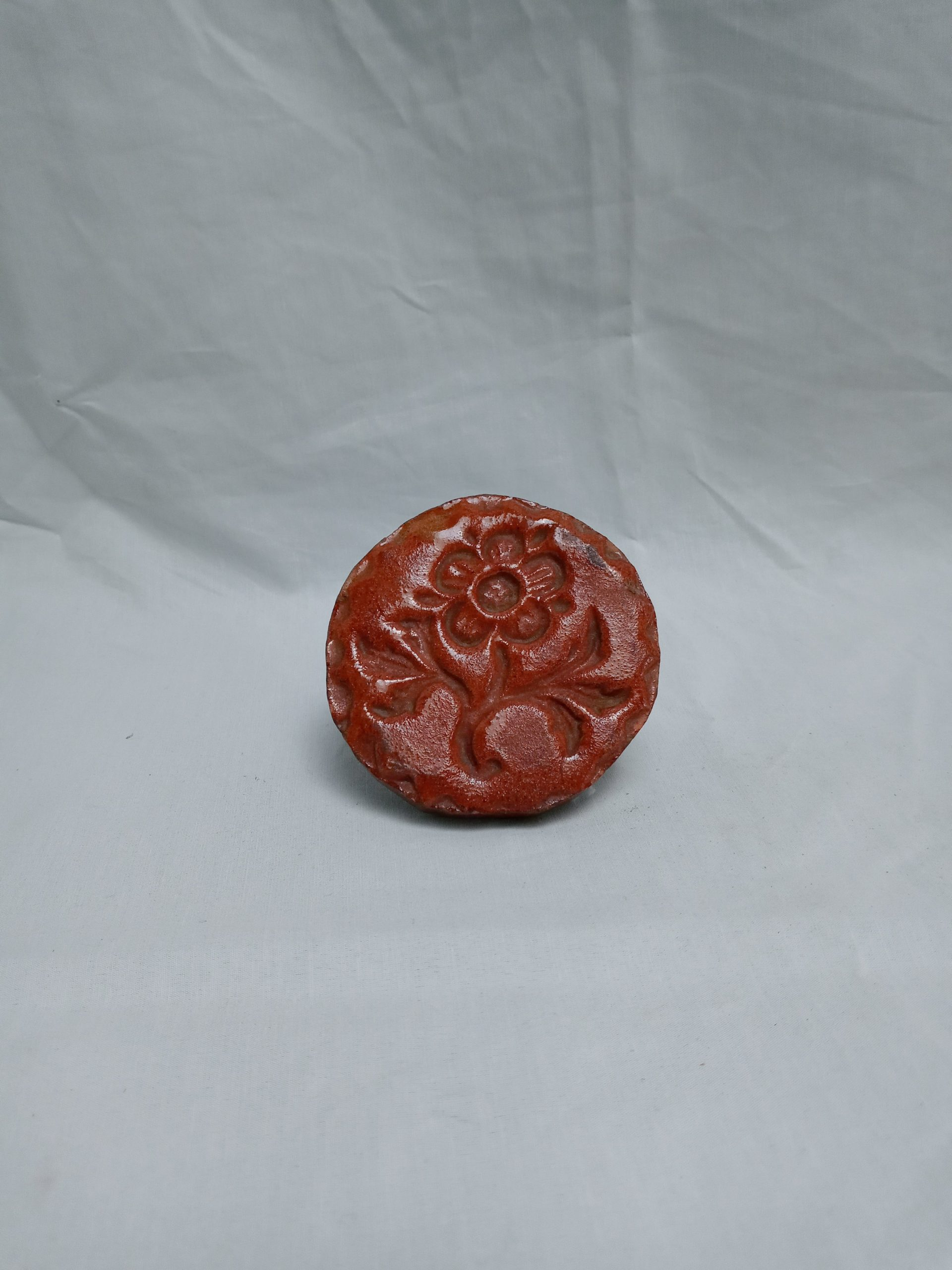 19-33238 Rare and unusual Redware Pottery butter print, floral impressed design, Pro. Pennsylvania. 19th Century. Image