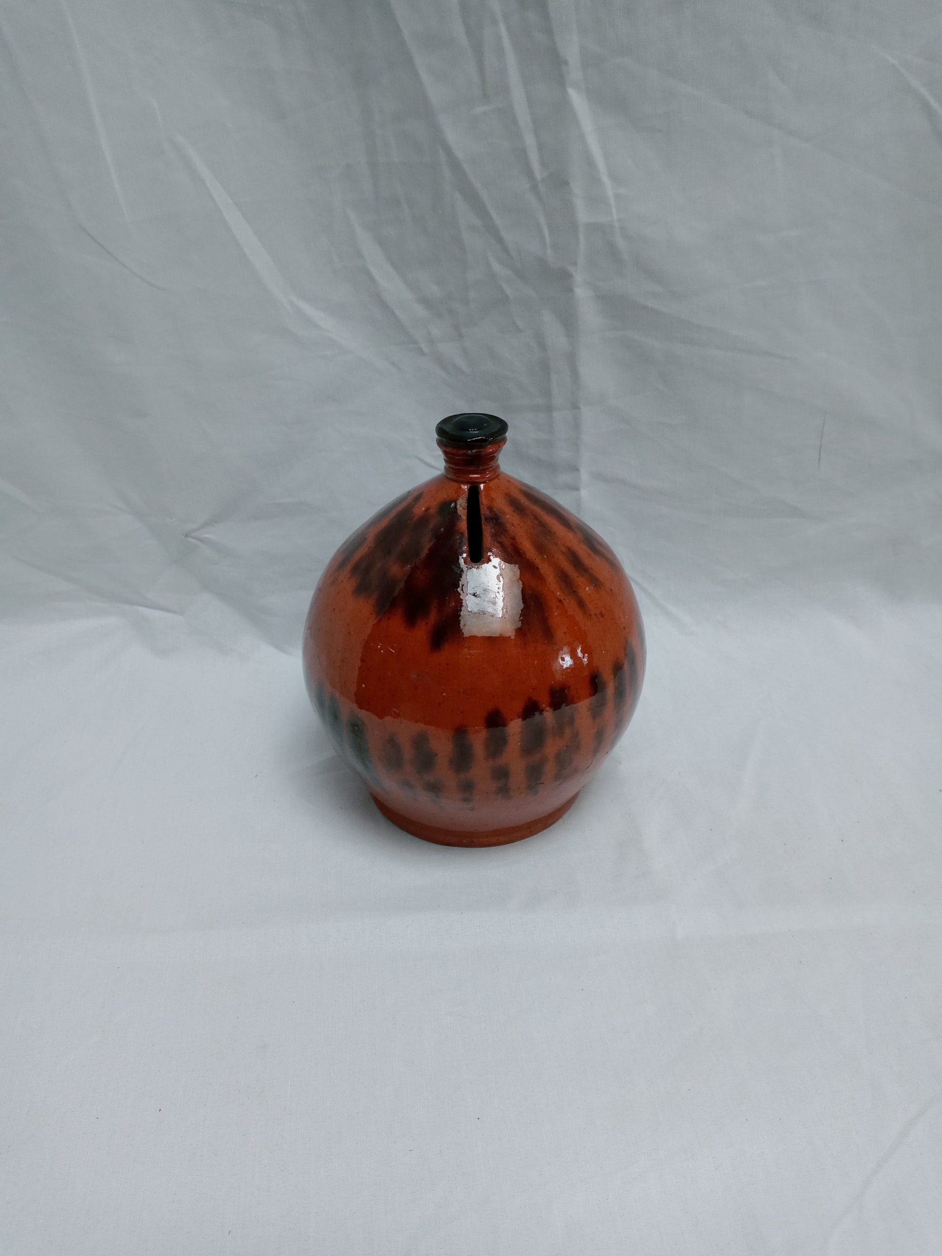 19-34023 Pennsylvania Redware Pottery Ovoid Penny bank, graphic black managanese decoration. Image