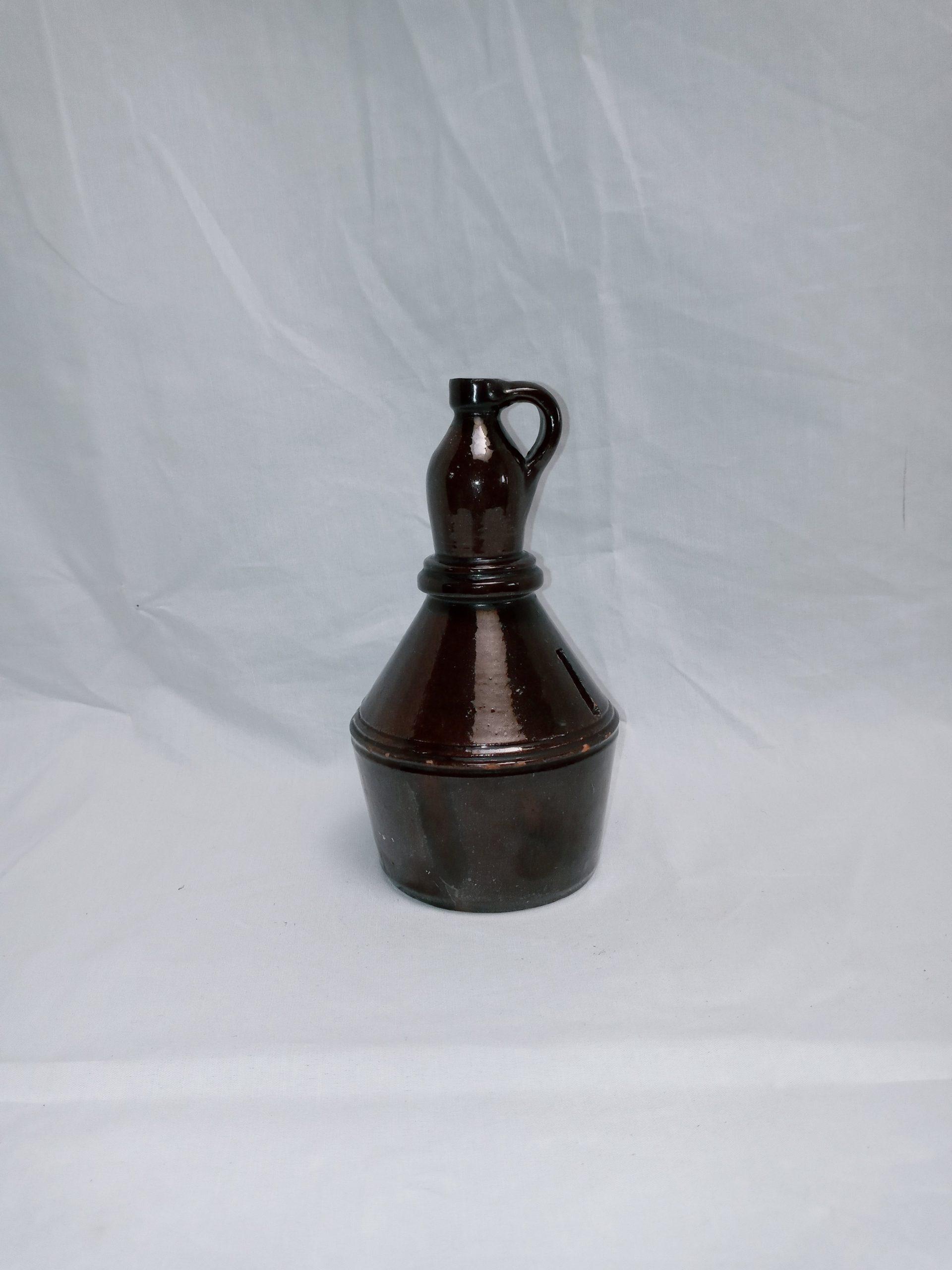 19-34729 Rare small Pennsylvania Redware Pottery Penny bank figural jug, dark managanese glaze, fine condition, 19th Century. Image