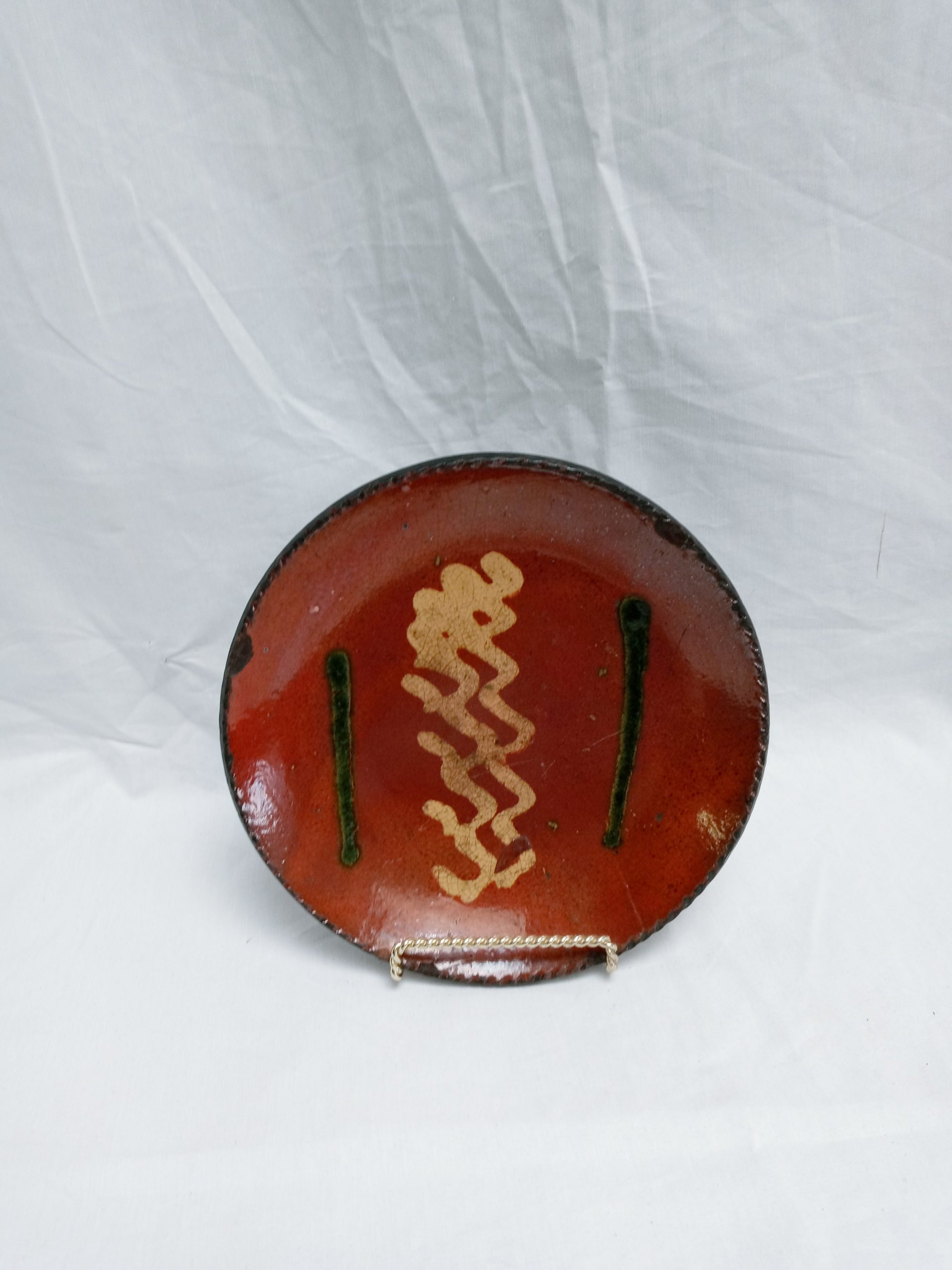 27-17343 Pennsylvania Redware Pottery Plate, yellow and green slip decoration. Image