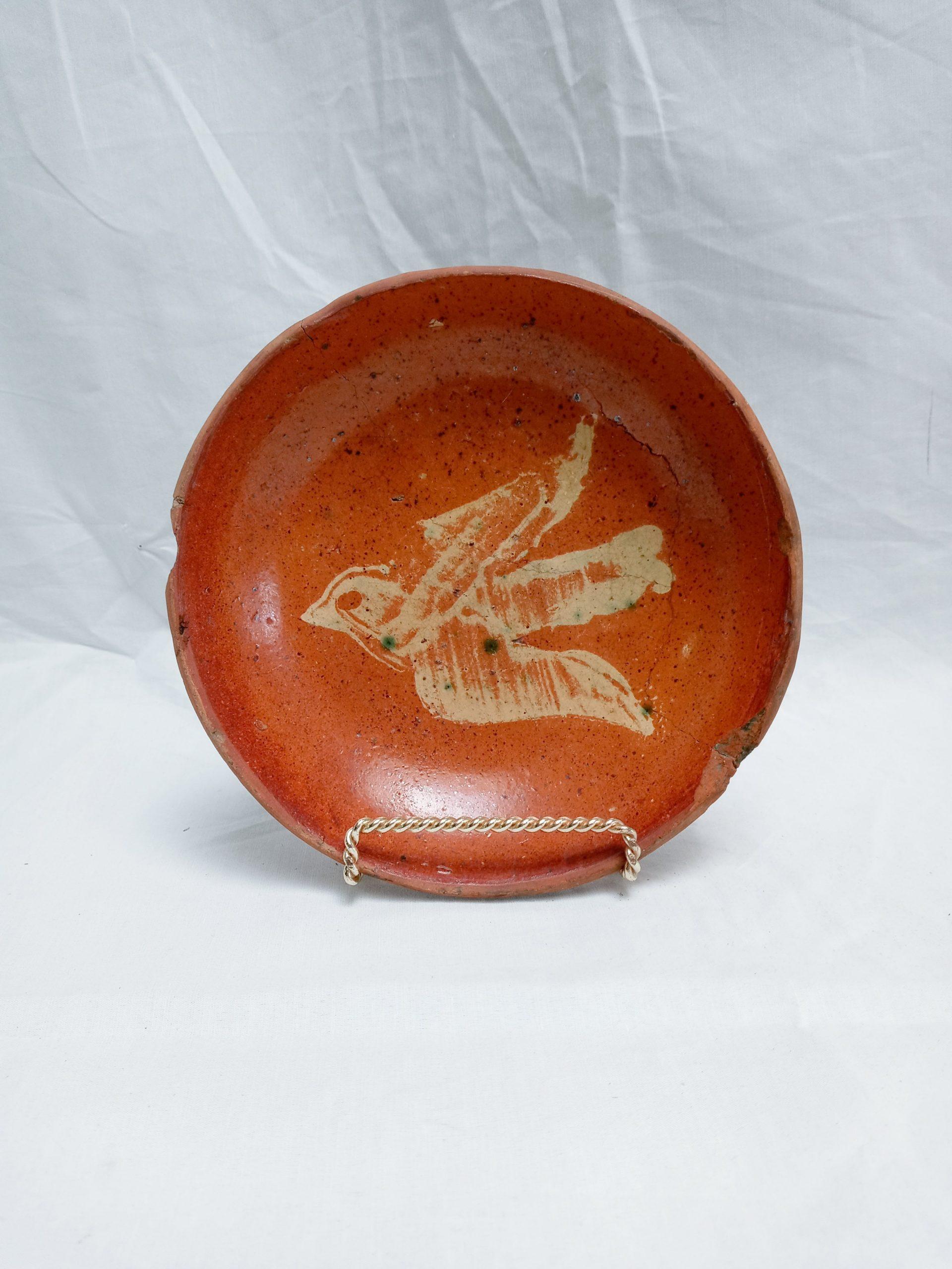 31-22286 Pennsylvania Redware Pottery Plate, rare yellow slip, bird in flight decoration, rim chips. Image